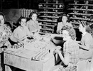 Women making cup handles