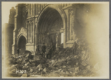 The ruins of Ypres Cathedral. N.Z. troops looking for souveniers.