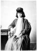 Studio portrait of seated Maori woman wearing hat ...