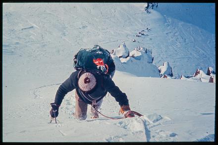 [Climber on snow face]