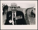 Veteran wearing medals, pins and commemorative Dia...