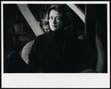 Portrait of the artist Robin White sitting in a ch...