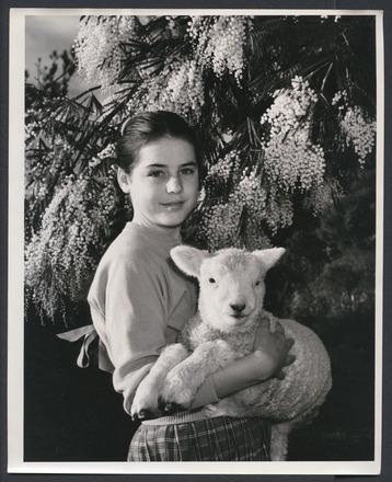 Girl with pet lamb
