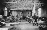 Interior view of barracks, several soldiers are si...