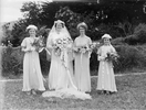 Group portrait of a bride, a bridesmaid or maid of...