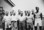 Group photograph of ten men at Waiouru military ca...