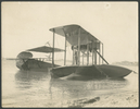Seaplane, double winged, monohull, in shallow wate...