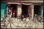 Carpet shop and bikes.