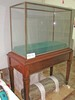 glass display case and base, square, base lined wi...