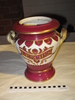 lidded ceramic urn white ground with cherry red/pi...