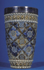 mug, with metal rim and moulded pattern in blue to...