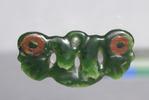 Greenstone pendant. This pendant is dark green wit...