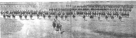 """Panorama: Fourth New Zealand Rough Riders Regiment on Parade at Klerksdorp, Transvaal, 26 November 1900 - Major R H Davies Commanding from the book """"With the Fourth New Zealand Rough Riders"""" by James G Harle Moore, 1906. - No known copyright restrictions"""