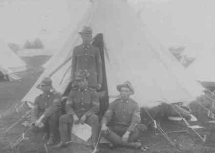 Postcard. 1918. 4 soldiers outside a tent. Sent by Tohe to Miss Rene Freeman, Chamberlain Street, Grey Lynn. Man seated with map is Walter Tohe Haeata. - No known copyright restrictions