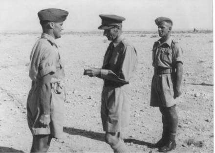 Bob Horrocks receiving his ribbon for his Military Cross. To the right of the photograph is Sergeant Keith Elliott who had just received his VC. - This image may be subject to copyright