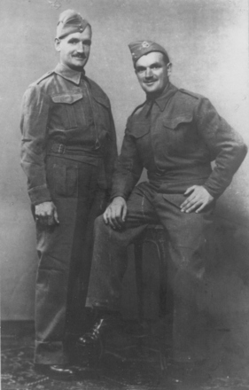 Group, 2 soldiers, brothers, Thomas Buchanan Johnston (2234) (seated) with Douglas Johnston prior to their embarkation. - This image may be subject to copyright