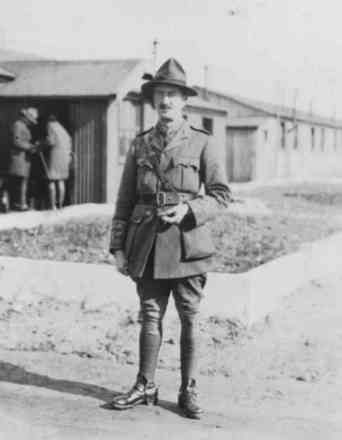 Portrait, standing outside military huts - No known copyright restrictions