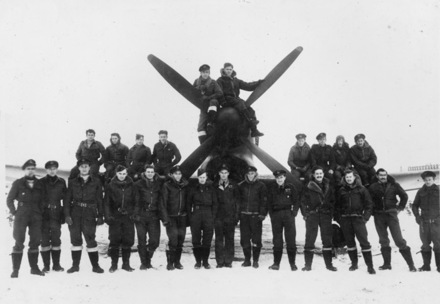 In snow at Volkel January 1945. Image from Lee Melles collection. Caption from Sortehaug, P. (1998). p. 207. left to right, back row: Keith Alexander Smith, William Arthur Kalka, William John Campbell, Andrew Ralph Evans, Neville Joseph Powell, Brian John O Connor, Owen David Eagleson, William Alan Liddell Trott, Loyd James Appleton, Raymond Jack Danzey. Front row; Sydney john Short, Colin James McDonald, Thomas Michael Fenton, Cornelius James Sheddan, Harold Longley, Keith Frederick Thiele, Arthur Ernest Umbers, Evan Mackie, Joseph Crafts, Robert Spurdle, John Edward Wood, Ross Alexander Melles, Alan Clive Inclis, William Lister Miller. - This image may be subject to copyright