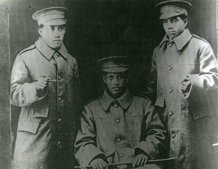 Portrait of three soldiers: Pa George Karika, Iaveta Karika, and Piat M. Mani in greatcoats, with uniform hats, a swaggar sticks. Rarotongan soldiers. - No known copyright restrictions