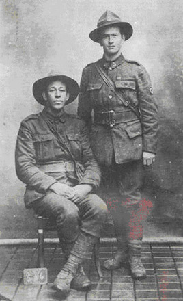 Brothers Private Richard (Dick) Alexander Henderson (3/258) (right) and his elder brother, Rifleman William John Henderson, (15369), NZ Rifle Brigade (seated). Almost definitely taken in France. Image provided by Nigel Robson. - No known copyright restrictions