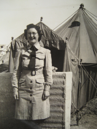 Portrait, WW2, WAAC, standing in front of tent in Egypt, Madge Tyson (kindly provided by family) - This image may be subject to copyright