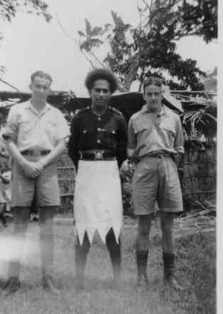 Photograph taken in Suva on 29 March 1942. Sergeant Joe Butler (69433) standing on the left with his hands in front, in the middle is a Fijian Policeman, and on the right is Sergeant Bill Arnold (69431). - This image may be subject to copyright