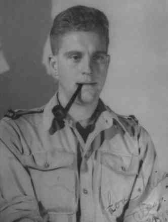 Alan Harold Fenton in uniform smoking a pipe, Rome, 24 September 1944, aged 21. - This image may be subject to copyright