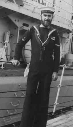 Portrait, Alan John Williamson, RNZN uniform standing on deck, his uniform with medal ribbons - This image may be subject to copyright