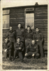 Group, WW2, Seven airmen in front of hut at 7 (p) A.F.U. Peterborough, England, July 1942. Back row left -right: Arn Southward (Christchurch) (NZ415380), Frank Robertson (USA), Laurie Turner (Christchurch), Maurice Gunther (Christchurch), Front row left -right: Alan Condon (Dunedin), Bernie Sheehan (Christchurch) (NZ415374), Ivan Gundersen (Christchurch) (NZ415313, NZ130586). (photo provided by Geoff Sheehan) - This image may be subject to copyright