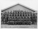 Group soldiers WW2, formal photograph. 207 Hut Trentham November 1940. Soldiers in front of 207 Hut, Trentham Camp, November 1940 (front). Includes Douglas Clayton in the front row, second from right. (S.C. Smith photo). Kindly donated by Linley Lipscombe (2007) - This image may be subject to copyright