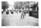 Wide view, headstones, Cairo War Memorial Cemetery, George Donnelly (23975) nephew of Frank Feather (12/734) standing behind his uncle's headstone, photographed during WW2 (kindly provided by family) - No known copyright restrictions