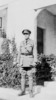 Portrait, Chaplain Wilson, standing outside a stone building he is wearing campaign medals (kindly provided by family) - No known copyright restrictions