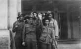Group, 28 Maori Battalion soldiers and unidentified soldiers standing in front of building Vailima (26147) standing left and cousin Alex Leger (26514) on far right c 1940 - This image may be subject to copyright