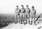 Group: 4 soldiers: Noel Gill, Bob Fleming, Ian Mackay, Colin Gibbard atop a pyramid in Egypt - This image may be subject to copyright