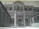 WW2, 4 men carrying soldier on a stretcher in front of the Grand Central Hotel Helwan Egypt (cWW2) from collections of Jack and Madge (nee Tyson) Callaghan - This image may be subject to copyright