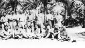 "Group, WW1, ""Taken on arrival in camp after chasing Turks for 5 days & nights Aug. 13th 1916. Standing: Lt. Coleman, Lt. Fossett, Maj. Wilkie, Col. Meldrum, Maj. Armstrong, Capt. Scott. Sitting: Capt. Wilder, Lt. Herrick, Lt. E.G.W, Lt. Levin, Lt. Pierce, Lt. Allison, Lt. Hall. "" Photographer A. Rhodes in E.G. Williams Album 211, Auckland War Memorial Museum Library - No known copyright restrictions"