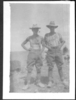 Group, WW1, 2 soldiers, one smoking a pipe not wearing a shirt, other with both hands in his pockets, (James Arthur Hunt (7/2275) collection) - No known copyright restrictions