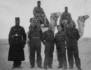 Group, 28 Maori Battalion soldier and 3 soldiers,in Egypt c. 1940, Vailima (26147) (2nd from left) and 3 unidentified soldiers, 3 Egyptians and 2 camels in desert - This image may be subject to copyright