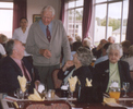 Informal, Murray Adlington standing talking to guests at a battalion AGM lunch 2006. - This image may be subject to copyright