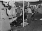 Conducting torpedo maintenance aboard HMNZS Bellona - This image may be subject to copyright