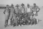 Cricket team, Company Mascot, WW2, 20 Battalion, D Company, Maadi, Egypt. Ron Withell (9274) standing second from left. Bull the company mascot dog in front. - This image may be subject to copyright