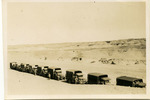 Convoy of trucks, halted in desert - This image may be subject to copyright
