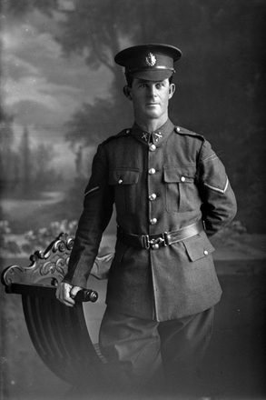 3/4 portrait of Lance Corporal Adair of the 28th Reinforcements, probably (Corporal in the roll) George William Adair, Reg No 54797, E Company.  (Photographer: Herman Schmidt, 1917). Sir George Grey Special Collections, Auckland Libraries, 31-A3330. No known copyright.