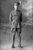 Full length portrait of Corporal (later Sergeant) Charles Lindsay Bevins, Reg No 40434, Specialist Company, Signal Section, 24th reinforcements. (Photographer: Herman Schmidt, 1916). Sir George Grey Special Collections, Auckland Libraries, 31-B2386. No known copyright.