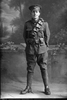 Full length portrait of Trooper Edward Bently Davies Reg No 13/2554, Auckland Mounted Rifles, 8th Reinforcements. (Photographer: Herman Schmidt, 1915). Sir George Grey Special Collections, Auckland Libraries, 31-D359. No known copyright.