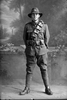 Full length portrait of Trooper Edward Bently Davies Reg No 13/2554, Auckland Mounted Rifles, 8th Reinforcements. (Photographer: Herman Schmidt, 1915). Sir George Grey Special Collections, Auckland Libraries, 31-D361. No known copyright.