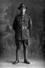 Full length portrait of Lance Corporal Leonard Booker, Reg No 55173, New Zealand Medical Corps. (Photographer: Herman Schmidt, 1917). Sir George Grey Special Collections, Auckland Libraries, 31-B3567. No known copyright.
