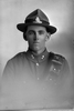 1/4 portrait of Gunner Charles Caradus, Reg No 17620, of the New Zealand Field Artillery (Photographer: Herman Schmidt, 1916). Sir George Grey Special Collections, Auckland Libraries, 31-C1936. No known copyright.