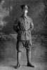 Full length portrait of Sergeant Major Frederick Widdowson Doidge, Reg No 20913, of the Auckland Infantry Battalion, - A Company. 18th Reinforcements. (Photographer: Herman Schmidt, 1916). Sir George Grey Special Collections, Auckland Libraries, 31-D1946. No known copyright.