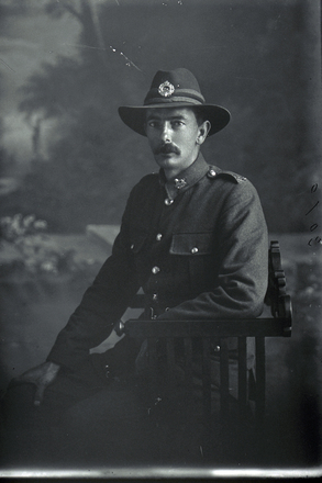 3/4 portrait of Private John Stanley Daubeny, Reg No 52387, of the 27th Reinforcements, E Company. (Photographer: Herman Schmidt, 1917). Sir George Grey Special Collections, Auckland Libraries, 31-D3079. No known copyright.